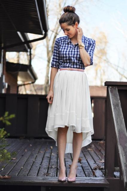 Mira con blanco con cinturón falda alta y baja botón de camisa