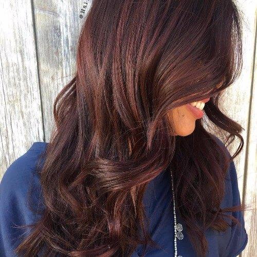 pelo largo rojo marrón ondulado