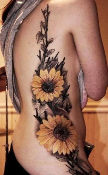Girasol tatuajes lado.