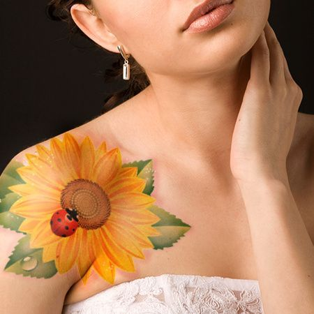 Girasol con Lady Bug Tattoo.