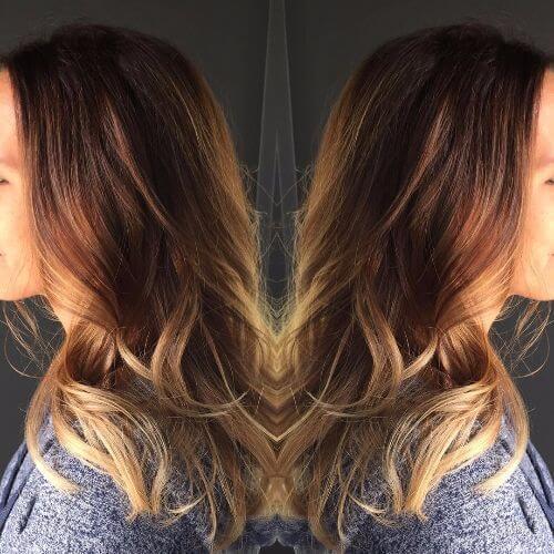 color de cabello color caramelo aplicado en cabello castaño oscuro