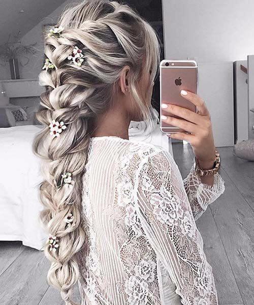 jumbo trenza y flores de cerezo peinados largos