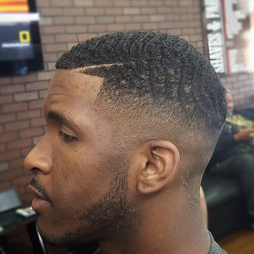 Peinados Mohawk para hombres negros Pelo corto
