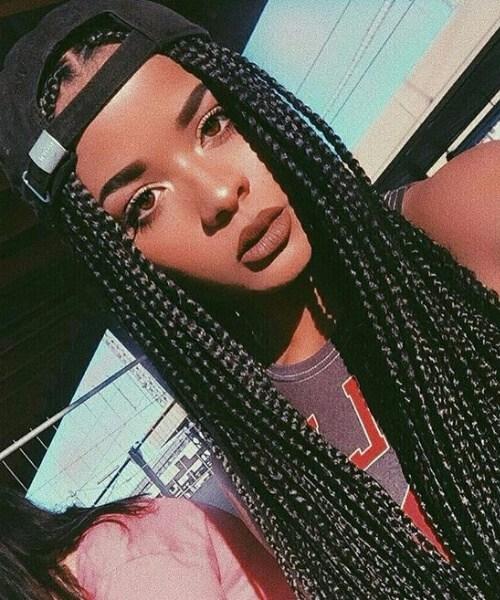 caja trenzas peinados chica negro