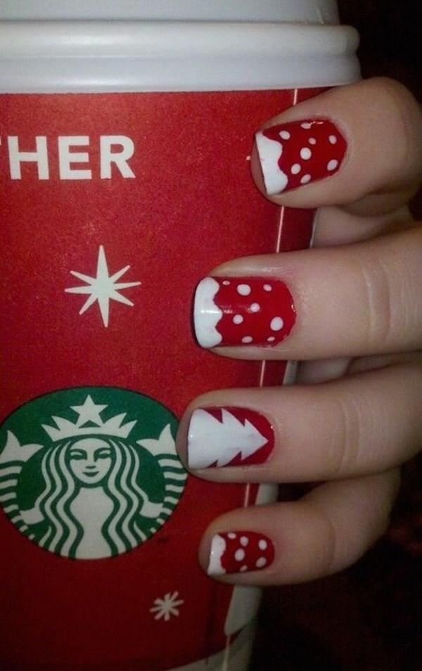 Blanco punteado en manicura de Navidad de base de uñas rojas.