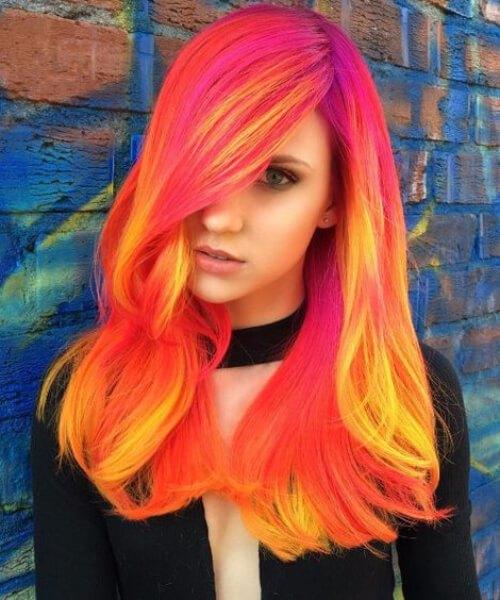 Dark Phoenix usando neones de colores de pelo de otoño Fuschia, Naranja, Amarillo