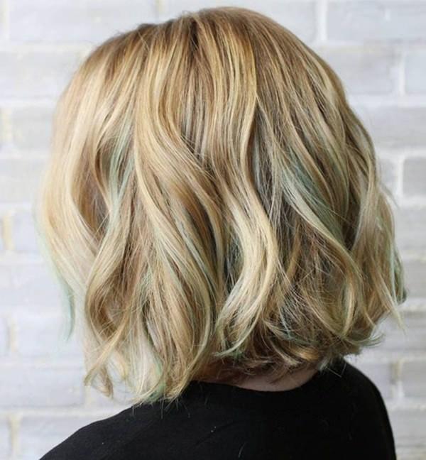 50280816-short-rizado-hairstyleshoneyblondewavybobwithpastelgreenhighlights