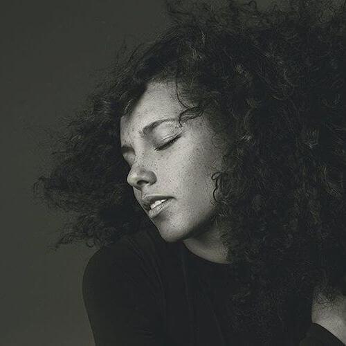 Alicia Keys peinados para cabello rizado