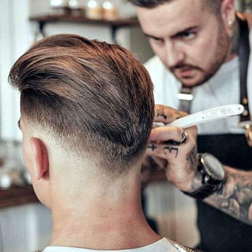 Peinados modernos desvaídos en forma de V para hombres