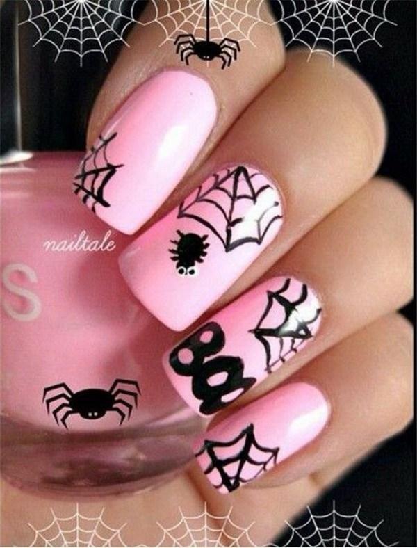 Diseño de uñas rosa y negro de Halloween. Ideas de arte de uñas de Halloween.