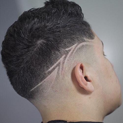 Cortes de pelo para hombres con diseños afeitados