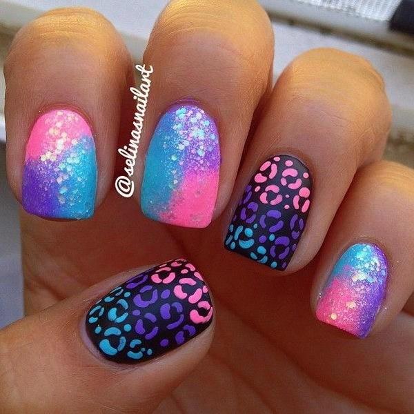 Un arte de uñas muy brillante con diseños coloridos de estampados de animales.  Seguramente te encantará jadear.