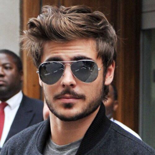 Peinado moderno pompadour para hombres con el pelo ondulado