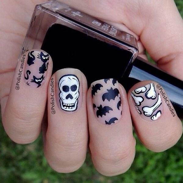 Diseños de uñas mate negro y blanco para Halloween. Ideas de arte de uñas de Halloween.