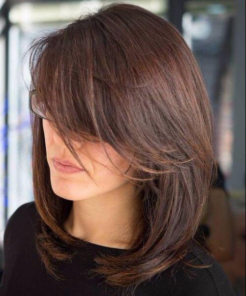 lado barrido flequillo hombro longitud peinados