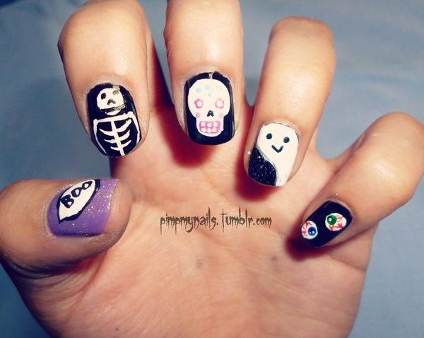 Ideas de diseño de Halloween para uñas cortas. Ideas de arte de uñas de Halloween.