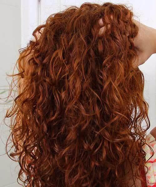 peinados largos rizados naturales