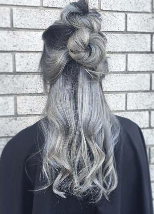cabello gris dos nudos superiores sucios
